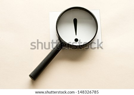 Magnifying glass and card - stock photo