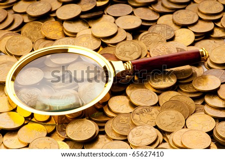 Magnifying glass and coins at the background