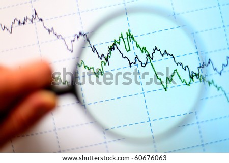 Magnifying glass and diagram - stock photo
