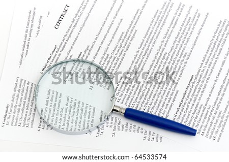 Magnifying Glass and document close up - stock photo