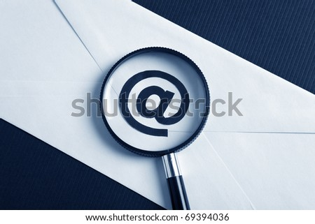 Magnifying Glass and e-mail, concept of E-Mail Security - stock photo