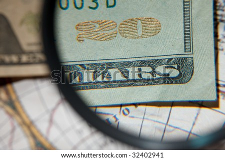 magnifying glass and paper currency