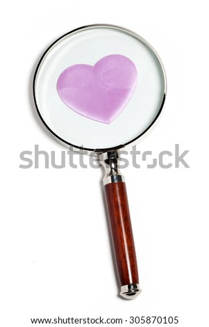 magnifying glass and pink heart - stock photo