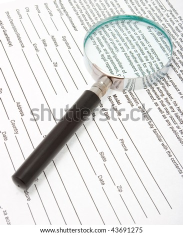 Magnifying glass and text on paper