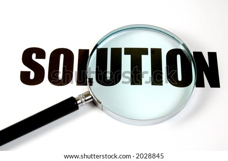 Magnifying glass and text - solution. - stock photo