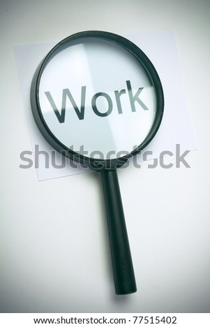 "Magnifying glass and text ""work"""