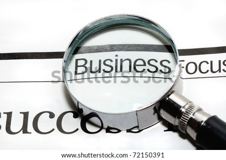 Magnifying glass and word business - business background - stock photo