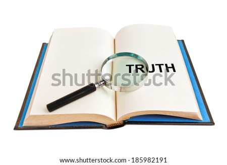 """magnifying glass and word """"truth"""" on book - stock photo"""
