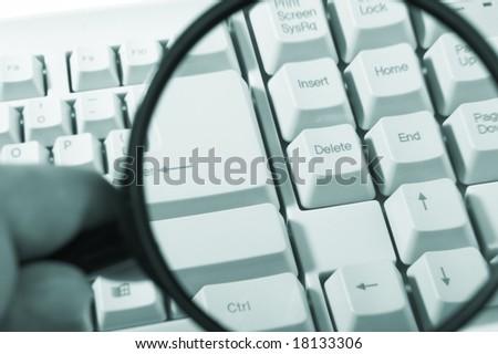 Magnifying glass, button, key - stock photo