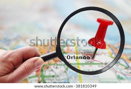 Magnifying glass closeup of Orlando Florida map                                 - stock photo
