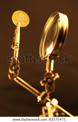 magnifying glass & 1 euro coin - stock photo