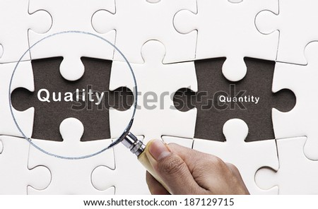 """Magnifying glass focus on  """"Quality""""  - stock photo"""