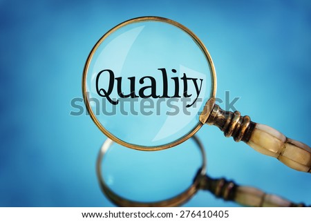Magnifying glass focus on word quality concept for quality control, customer satisfaction and excellence - stock photo
