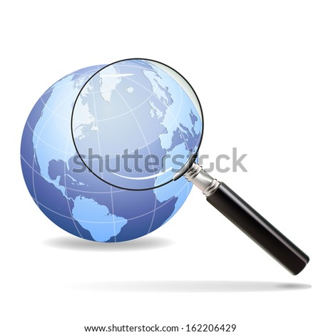 Magnifying glass focuses on the old continent on the planet earth - stock photo