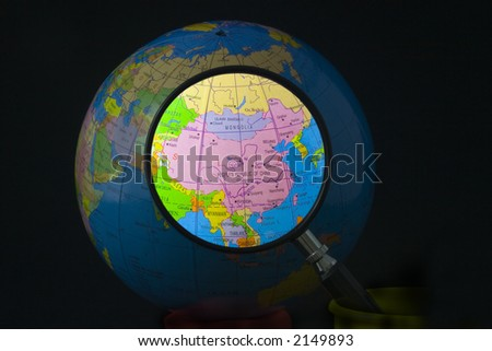 Magnifying glass focusing on China - stock photo