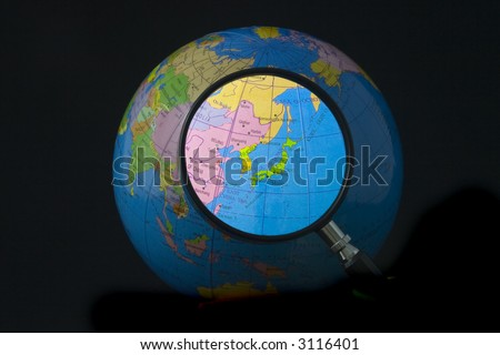 Magnifying glass focusing on Japan and Korea - stock photo