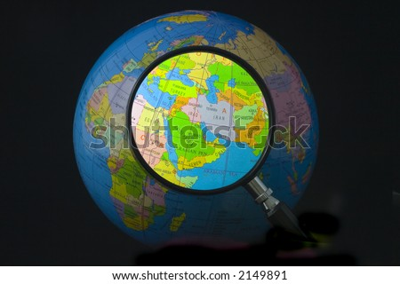 Magnifying glass focusing on Middle East - stock photo