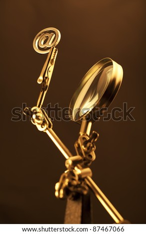 magnifying glass & gold internet symbol
