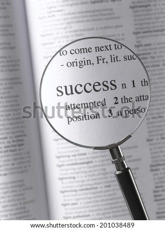 Magnifying Glass Highlighting Success - stock photo