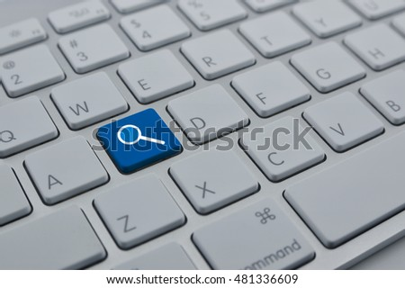 Magnifying glass icon on modern computer keyboard button, Searching internet concept