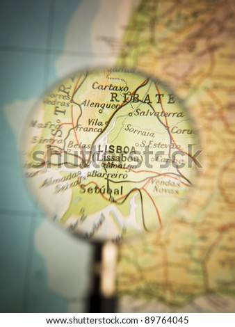 Magnifying Glass in front of a Lisboa map - stock photo