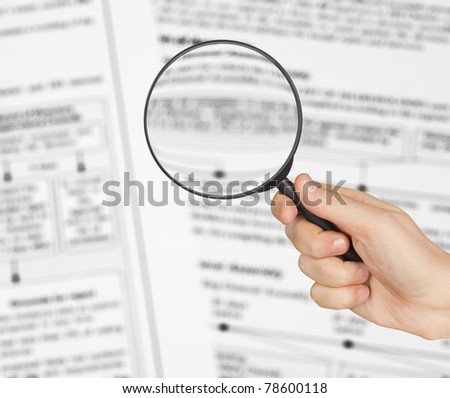 Magnifying glass in hand and text - business background