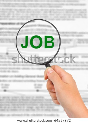 Magnifying glass in hand and word Job - business concept - stock photo