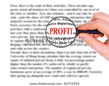 Magnifying glass in hand and word profit - stock photo