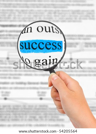 Magnifying glass in hand and word Success, business background - stock photo