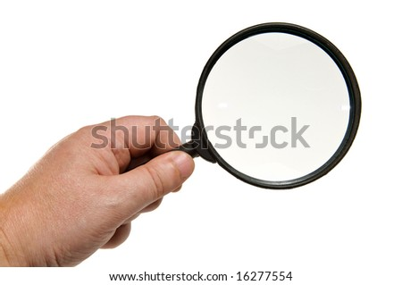 Magnifying glass in hand, isolated on white