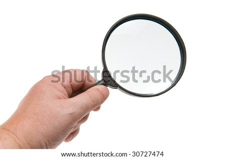 magnifying glass in hand isolated on white