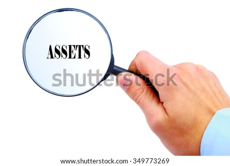 "Magnifying glass in hand isolated on white background searching ""Assets"""