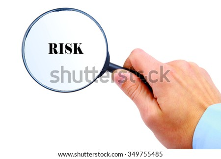 "Magnifying glass in hand isolated on white background searching ""Risk"""