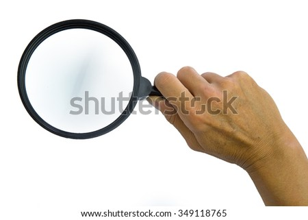Magnifying glass in woman hand. Isolated on white