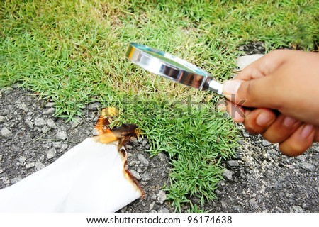 magnifying glass make burning white paper - stock photo