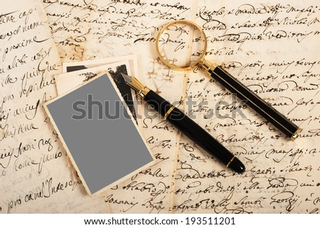 magnifying glass on an old handwritten letter