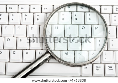 Magnifying glass on an white keyboard