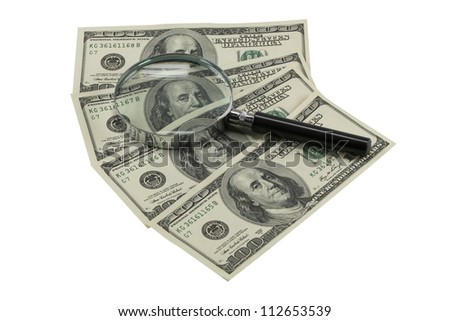 Magnifying glass on banknotes (with clipping path) - stock photo