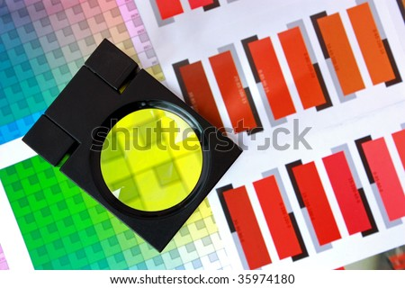 Magnifying Glass on Color Swatches Series Focused on magnifying glass - stock photo