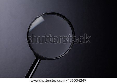magnifying glass on dark background