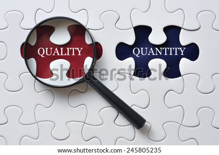 """Magnifying Glass On Missing Puzzle with """"QUALITY/QUANTITY"""" Word, Antonym Concept and Selective Focus  - stock photo"""