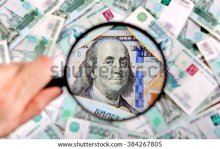 Magnifying Glass on the American Dollars Background - stock photo