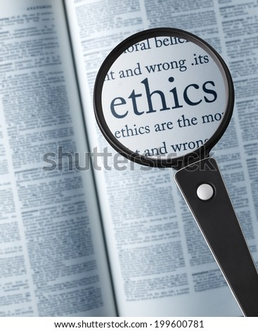 """Magnifying glass on the""""ethics"""" in dictionary - stock photo"""