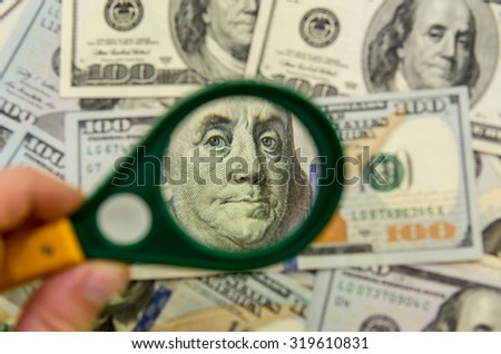 Magnifying Glass on the one hundred American Dollars - stock photo