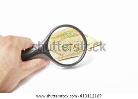 Magnifying Glass on the one One Cuban Pesos - stock photo