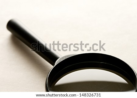Magnifying glass on the paper background - stock photo