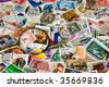 magnifying glass on vintage stamps - stock photo