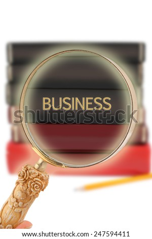 Magnifying glass or loop looking on an educational subject - Business with a glow - stock photo