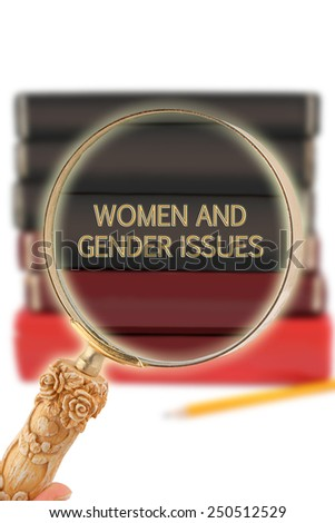 Magnifying glass or loop looking on an educational subject - Women and Gender Issues - stock photo