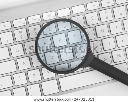 Magnifying glass over a keyboard